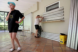 September 8, 2017 - Miami, Florida, U.S. - Yvette Sedeno, 62, left, and Ray Sedeno, 62, install storm shutters on to their windows on their lanai while preparing for the arrival of Hurricane Irma on Friday afternoon in unincorporated Dade County, south of Miami. (Credit Image: © Douglas R. Clifford/Tampa Bay Times via ZUMA Wire)