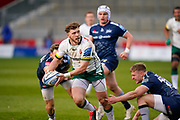 London Irish Centre Theo Brophy-Clews breaks through the Sale Sharks defence during a Gallagher Premiership Round 14 Rugby Union match, Sunday, Mar 21, 2021, in Eccles, United Kingdom. (Steve Flynn/Image of Sport)