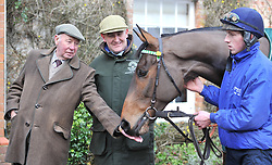 File photo dated 17-01-2012 of Donald McCain Jnr with horse Ballabriggs and the horses owner Trevor Hemmings (left). Issue date: Tuesday October 12, 2021.