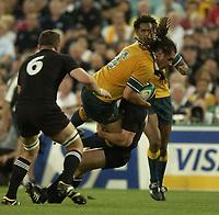 Photo: Richard Lane.<br />New Zealand v Australia. Semi-Final, at the Telstra Stadium, Sydney. RWC 2003. 15/11/2003. <br />George Smith attacks.