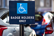 Disabled badge holders signs  in the car park of a supermarket, Stoke Newington. London, UK.