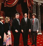 Washington, DC  1983/01/05 Senator Ted Kennedy and Rep Joe Kennedy with Vice President , H.W. Bush (Bush 41) participates in the mock swearing in of Senators in the recreation of the supreme Court Chambers in the U.S. Capitol<br />Photo by Dennis Brack