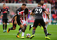 Mame Diouf of Stoke city (c)  battles for the ball with Granit Xhaka of Arsenal. Premier league match, Stoke City v Arsenal at the Bet365 Stadium in Stoke on Trent, Staffs on Saturday 19th August 2017.<br /> pic by Bradley Collyer, Andrew Orchard sports photography.