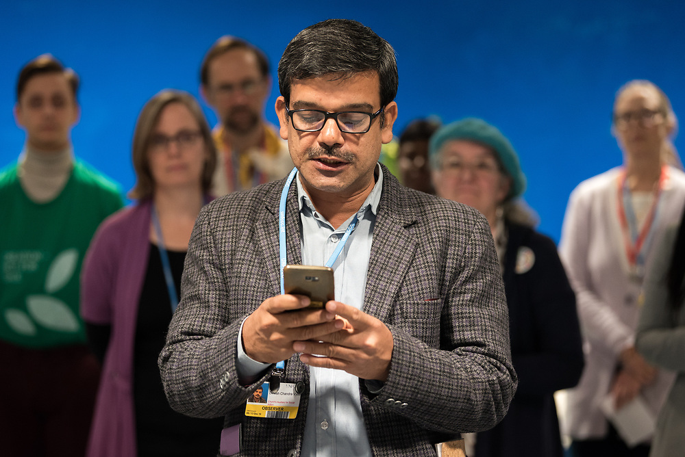 13 December 2019, Madrid, Spain: Dinesh Vyas from CASA, India, reads a word of prayer, as faith-based organizations gather for a vigil, as COP25 is about to draw to a close, praying that negotiations will bear fruit, bringing about urgent and just action to find a way out of the climate crisis.