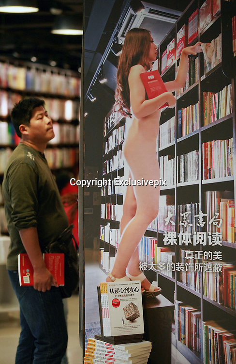 """NANJING, CHINA - OCTOBER 19: (CHINA OUT) <br /> <br /> Nude Reading In Nanjing<br /> <br /> A bookstore holds a photography show with the theme of """"Nude Reading"""" on October 19, 2013 in Nanjing, Jiangsu Province of China. <br /> ©Exclusivepix"""