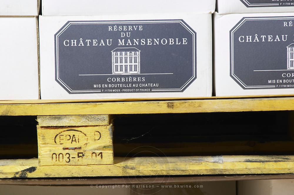 Wine case carton. Chateau Mansenoble. In Moux. Les Corbieres. Languedoc. Barrel cellar. France. Europe.