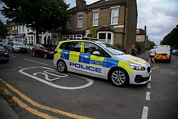 © Licensed to London News Pictures. 24/08/2020. London, UK. A police car arrives at St James Park, Walthamstow, East London as detectives launch an investigating following the discovery of a man's body. Police were called by a member of the public at approximately 13:40hrs to St James Park, E17, after a person was found unresponsive. A man, aged in his thirties, was pronounced dead at the scene. Photo credit: Dinendra Haria/LNP