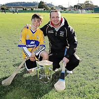 3 December 2011; Clare manager Davy Fitzgerald with Conor Cassidy from the San Francisco GAA Club, and the Liam MacCarthy Cup, after a coaching session organised as part of the tour. Conor's dad, Leo, is from Kilfinora, Co Clare. 2011 GAA GPA All-Stars Hurling Tour sponsored by Opel, Treasure Island, San Francisco, California, USA. Picture credit: Ray McManus / SPORTSFILE *** NO REPRODUCTION FEE ***