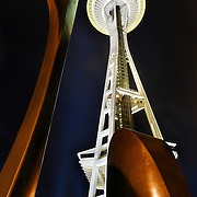 The Space Needle at night with sculpture in the foreground
