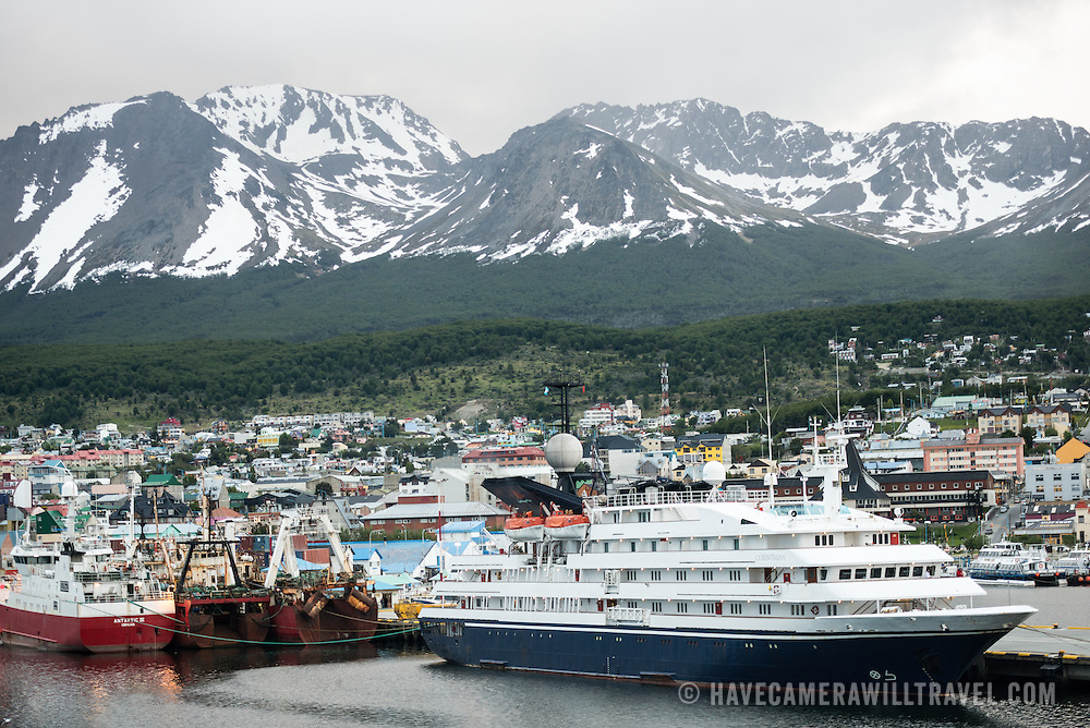 A cruise ship and fishing boats docked at the port in Ushuaia in southern Argentina, a popular gateway to Antarctic expeditions and cruises.