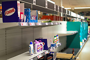 March 16, 2020, London, England, United Kingdom: Empty shelves are seen at a store, in London, Monday, March 16, 2020. For most people, the new coronavirus causes only mild or moderate symptoms, such as fever and cough. For some, especially older adults and people with existing health problems, it can cause more severe illness, including pneumonia. (Credit Image: © Vedat Xhymshiti/ZUMA Wire)