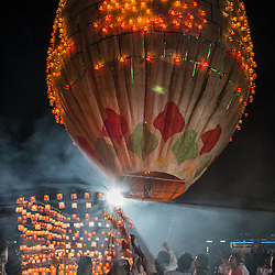 """This balloon has been adored with candles called """"Sein Na Pan"""". Instead of firework it will carry an additional assortment of candles underneath. Since the balloon is already inflated, it won't take long until it eventually takes off to brighten up the sky over Taunggy with romantic candle light."""