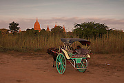 Wagon driver awaits for tourists outside a temple, Bagan is one of the biggest tourist atractions in Myanmar because of its more than two thousand temples, in Burma.<br /> Note: These images are not distributed or sold in Portugal