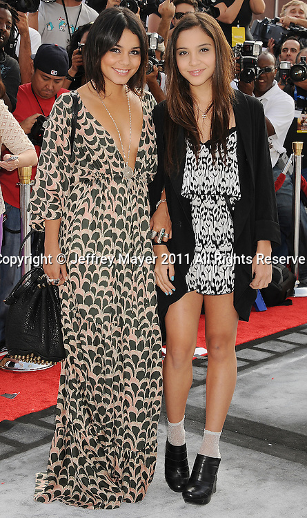 """HOLLYWOOD, CA - SEPTEMBER 25: Vanessa Hudgens and Stella Hudgens attend Premiere Of """"Iris"""" - A Journey Into The World Of Cinema By Cirque du Soleil at the Kodak Theatre on September 25, 2011 in Hollywood, California."""