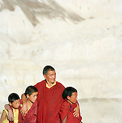 Mature monk with three monk boys, Ladakh, India