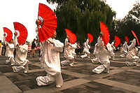 The Chinese Fan Dance is known for its beautiful and delicate poses.  Similar in style, the banner or handkerchief dance originated in the north of China. It is noted for its skilful and difficult motions. It is  popular among ordinary people and serves as a kind of exercise as well.