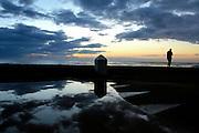 ALERIA, CORSICA - 18/09/2005 - TRAVEL, Tourist waking up at Aleria beach<br /> <br /> © Christophe VANDER EECKEN