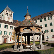 """VARNA, ITALY - OCTOBER 13: A view of  the main courtyard with """"Il Pozzo delle Maraviglie"""" at Abbazia di Novacella on October 13, 2010 in Varna, Italy. Abbazia di Novacella, in Alto Adige established in the year 1142 by Augustinian monks, is one of the oldest vineries in the world; it has a production of about 400,000 bottles of world class wines including Kerner, Sylvaner, Pinot Grigio, Gewurtztraminer."""