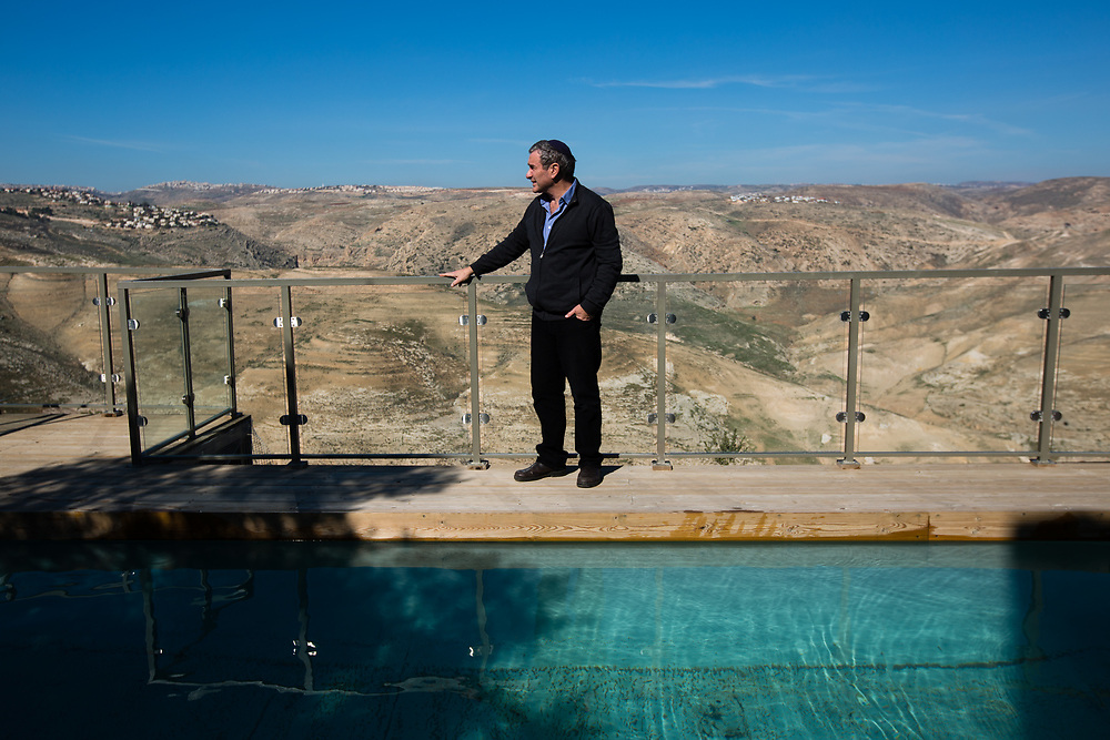 Israeli Jewish settler Igal Canaan is seen on a terrace overlooking Wadi Qelt (Nahal Prat in Hebrew) at his bed and breakfast 'Nof Canaan' which is advertised on Airbnb international home-sharing site and rental listings service, in the West Bank Jewish settlement of Nofei Prat, on January 28, 2016.
