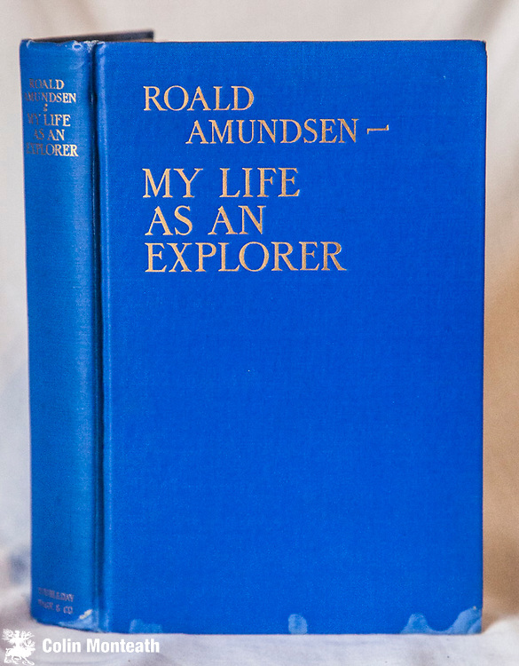 MY LIFE AS AN EXPLORER, Roald Amundsen, Double Day, New York, 1st USA edition, 1927,  280 page hardback in original blue cloth, gilt titles, minor foxing, maps, Amundsen's autobiography discusses in straightforward style the numerous difficulties of his many expeditions, ranging from problems of finance and planning through to dealing with life-threatening danger and inevitable controversy. Generously acknowledging an 'old gentleman in Grimsby' for providing materials that helped him plan the first navigation of the North-West Passage, Amundsen credits painstaking preparation as the cornerstone of his success, especially in the conquest of the South Pole. $140 ( Arnold Heine collection)