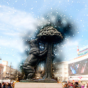 Digitally enhanced image of Bear and Berry tree statue the symbol of Madrid city photographed at Puerta del Sol, Madrid, Spain