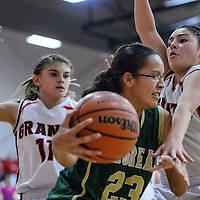 121214       Cable Hoover<br /> <br /> Thoreau Hawk Avery Sanders (23) drives past Grants Pirates Destiny Chavez (14) and Caroline Bachman (11) Friday at Grants High School.