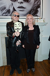 DEBBIE HARRY and CHRIS STEIN at a private view of Chris Stein/Negative: Me, Blondie And The Advent Of Punk, held at Somerset House, The Strand, London on 5th November 2014.