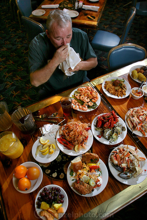 Carson 'Collard Green' Hughes Eating at a an all you can eat seafood buffet in Newport News, Virginia, in preparation for a contest. He died at 44 in December 2008. (From the book What I Eat: Around the World in 80 Diets.)  MODEL RELEASED.