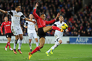 Cardiff city's Peter Odemwingie © has a shot at goal. Barclays Premier League match, Cardiff city v Swansea city at the Cardiff city stadium in Cardiff, South Wales on Sunday 3rd Nov 2013. pic by Andrew Orchard, Andrew Orchard sports photography,