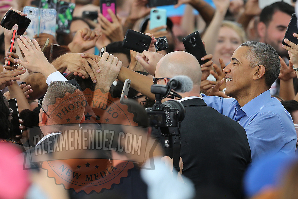 President Barack Obama shakes hands with supporters as he campaigns for Democratic nominee Hillary Clinton at Osceola Park in Kissimmee Florida USA  06 Nov 2016
