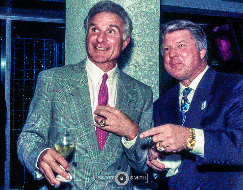 Former linebacker Nick Buoniconti and Coach Jimmy Johnson share laughs during Coach Johnson's private Super Bowl XXIX party in the newly opened Three Rings Bar and Grill, Eden Roc Resort, Miami Beach, 1995.
