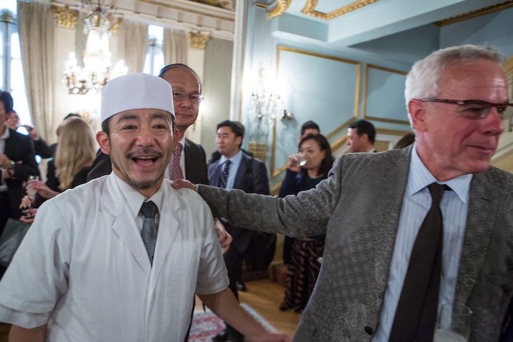 New York, NY - 3 June 2016. Chef David Bouley, right, talking to chef Kamiya, the personal chef of the Reiichiro Takahashi, the Japanese Ambassador, after a ceremony awarding Bouley the title Japanese Cuisine Goodwill Ambassador for his work in bringing Japanese cuisine to the U.S. Bouley later invited Kamiya to visit at brushstroke, Bouley's Japanese restaurant in New York.