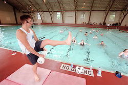An unidentified lifeguard, left, leads a water aerobics class at the Plunge in Hayward, Calif., Monday, Aug. 7, 2000. (Photo by D. Ross Cameron)