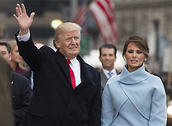 January 20, 2017 - Washington, DC, UNITED STATES - President Donald Trump and First Lady Melania Trump walk in their inaugural parade after being sworn-in as the 45th President in Washington, D.C. on January 20, 2017. (Credit Image: © Kevin Dietsch/CNP via ZUMA Wire)
