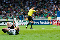 Marc Oliver Kempf of Germany lying on the ground after crash with Corentin Jean of France crashes and in background the referee gives a penalty for France during the UEFA European Under-17 Championship Group A match between Germany and France on May 10, 2012 in SRC Stozice, Ljubljana, Slovenia. Germany defeated France 3:0. (Photo by Matic Klansek Velej / Sportida.com)