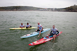 © Licensed to London News Pictures. English Channel. UK 27/07/2011. Surf Relief UK paddlers Dave Manley, Nick Thorn, Phil Williams and Toby Lowe paddle surf boards across the 22 miles of the English Channel from Shakespeare Beach, Dover to Cap Gris Nez in France yesterday (26/07/2011). The team smashed their previous predicted 6 hour time, crossing in 5 hours 20 minutes. The team will raise more than £3000 for Surf Relief UK which provides surfing lessoms for disabled and disadvantaged children across the UK. Photo credit: Manu Palomeque/LNP