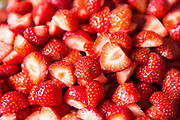 Freshly cut garden strawberries ready to eat at a summer party.