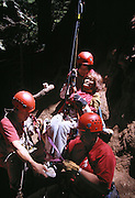Various members of Tree Climber International assisting  a paraplegic member who with aid of her friends climbed and camped a night at the top of the Stagg Tree.