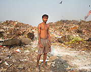 A man who collects garbages. Located next to a lake, a visit to one of the main garbage dump in Kolkata. With 15 millions population in 2019 and growing, the city of Calcutta is a typical case of expansion through uncontrolled urbanization.