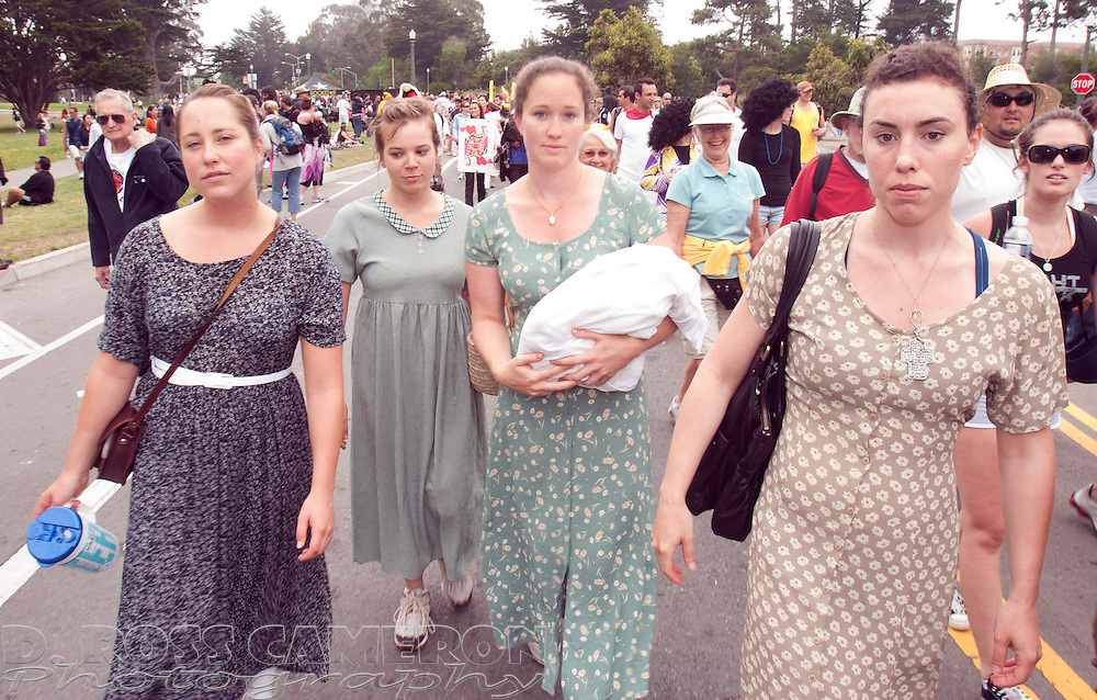 Paige Lansitz, from left, Mary Chapman, Elizabeth Balassone and Gaylen Hafner came dressed as members of a polygamous sect to the 97th running of the Bay to Breakers 12K race, Sunday, May 18, 2008 in San Francisco. (Photo by D. Ross Cameron)