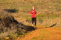 Heather Harrison trail running in the Sierra Foothills near Auburn, CA.