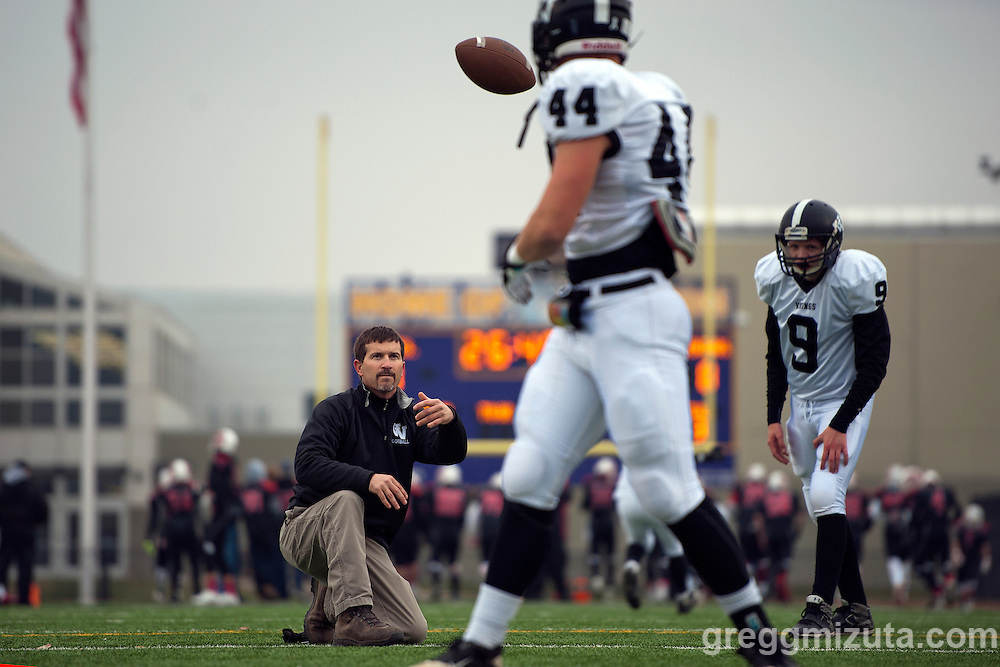 Vale coach Jeff Jacobs works with PAT snapper Trace Cummings and kicker Jakob Jernsletten before the start of the 3A Championship game at Kennison Field, Hermiston, Oregon, Saturday, November 28, 2015.<br /> <br /> Jakob Jernsletten averaged 42.6 yards on five kickoffs and was 3-4 on PAT in Vale's 27-20 win over Santiam Christian.