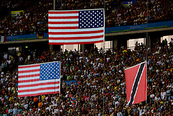 Flags of USA and Trinidad and Tobago during day eight of the 12th IAAF World Athletics Championships at the Olympic Stadium on August 22, 2009 in Berlin, Germany. (Photo by Vid Ponikvar / Sportida)
