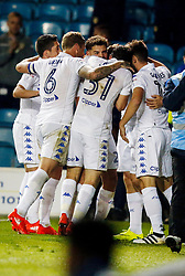 Leeds United's Chris Wood (hidden from view) celebrates scoring his sides first goal with team mates during the Leeds United v  Blackburn Rovers  EFL Cup Third Round at  Elland Road Stadium in Leeds.