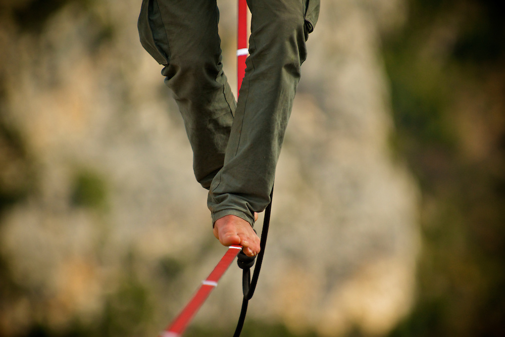 Elephant Slacklines ambassador Alexander Schultz on the return of his first FM ascent of the shortest leg of the first SPACE line, 300m high, and 65, 45,30m legs, rigged in the Sordidon sector of Verdon Gorges, France. A very, very saggy line indeed!! Even for the pros! ..©2012 Pedro Pimentel
