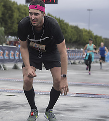 May 7, 2017 - Costa Mesa, CA, USA - An OC Half Marathon runner appears a little tipsy after completing the race in Costa Mesa, CA on Sunday, May  7, 2017. (Credit Image: © Mindy Schauer/The Orange County Register via ZUMA Wire)