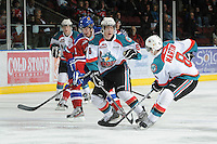 KELOWNA, CANADA, FEBRUARY 15: Stewart Coyle #6 of the Kelowna Rockets checks an Edmonton Oil Kings player at the Kelowna Rockets on February 15, 2012 at Prospera Place in Kelowna, British Columbia, Canada (Photo by Marissa Baecker/Shoot the Breeze) *** Local Caption ***