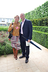 LAWRENCE DALLAGLIO and his wife ALICE at the RHS Chelsea Flower Show 2009 held inthe gardens of the Royal Hospital Chelsea on 18th May 2009.