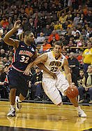December 29 2010: Iowa Hawkeyes guard/forward Eric May (25) drives around Illinois Fighting Illini guard Demetri McCamey (32) during the first half of an NCAA college basketball game at Carver-Hawkeye Arena in Iowa City, Iowa on December 29, 2010. Illinois defeated Iowa 87-77.
