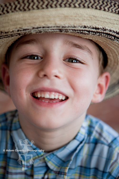 Boy (6 years old) smiles with Panama Hat